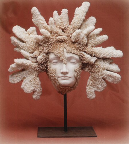 Faux Coral Face Statue On Iron Base